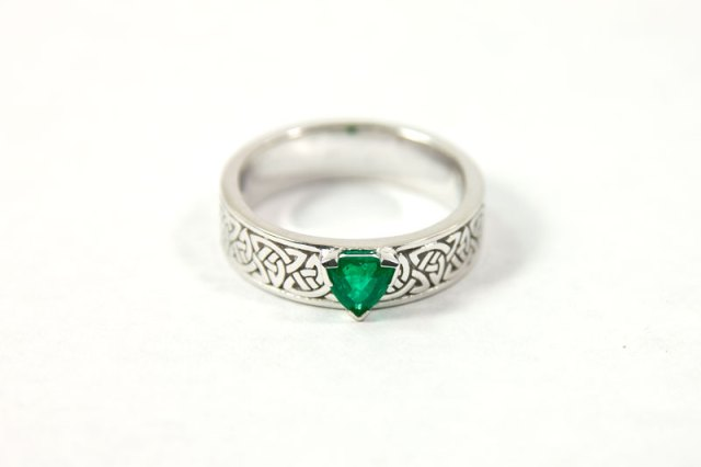 An Emerald and White Gold Engagement Ring