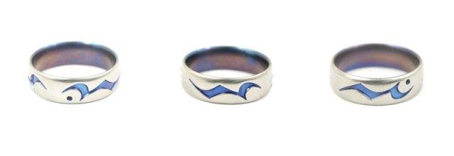 aerospace grade titanium engagement ring with musical symbols