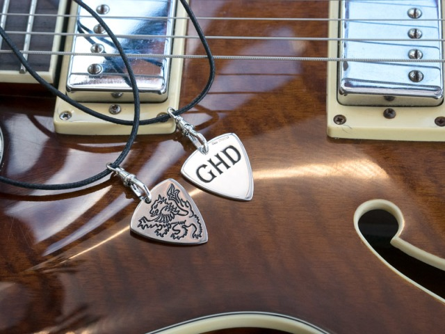 A Pair of Guitar Plectrums in Silver and Titanium